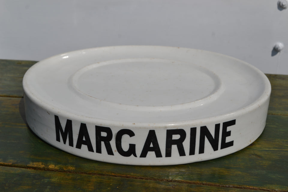 Circular Margarine grocers slab with scrolling Avery back stamp