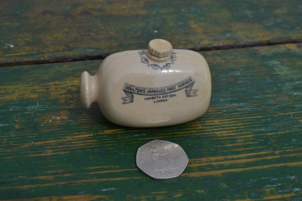 An Edwardian miniature Doulton footwarmer
