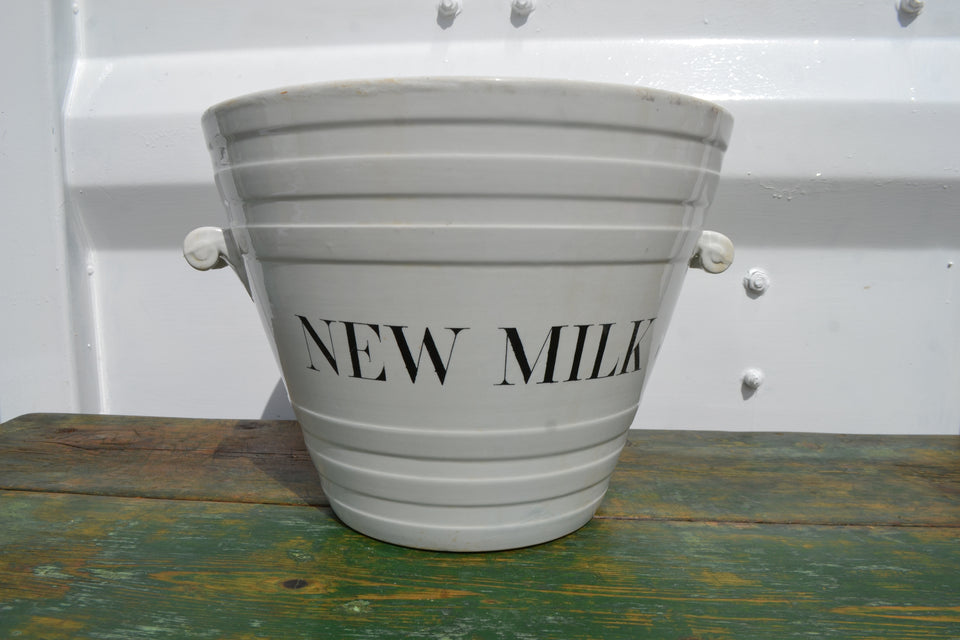 An antique white ironstone 'New Milk' pail