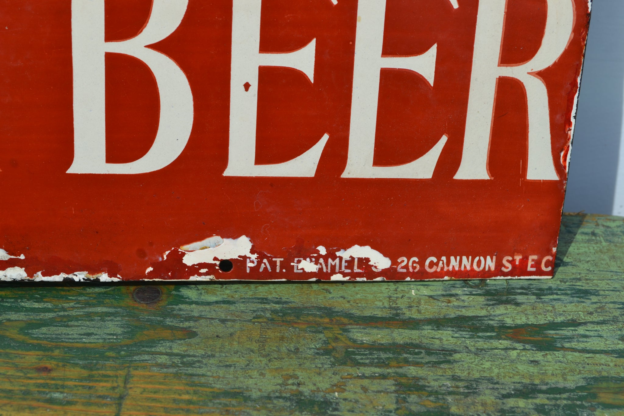 A Dartnell's Ginger Beer enamel sign