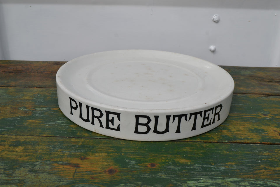 A circular Pure Butter slab with Parnall makers transfer