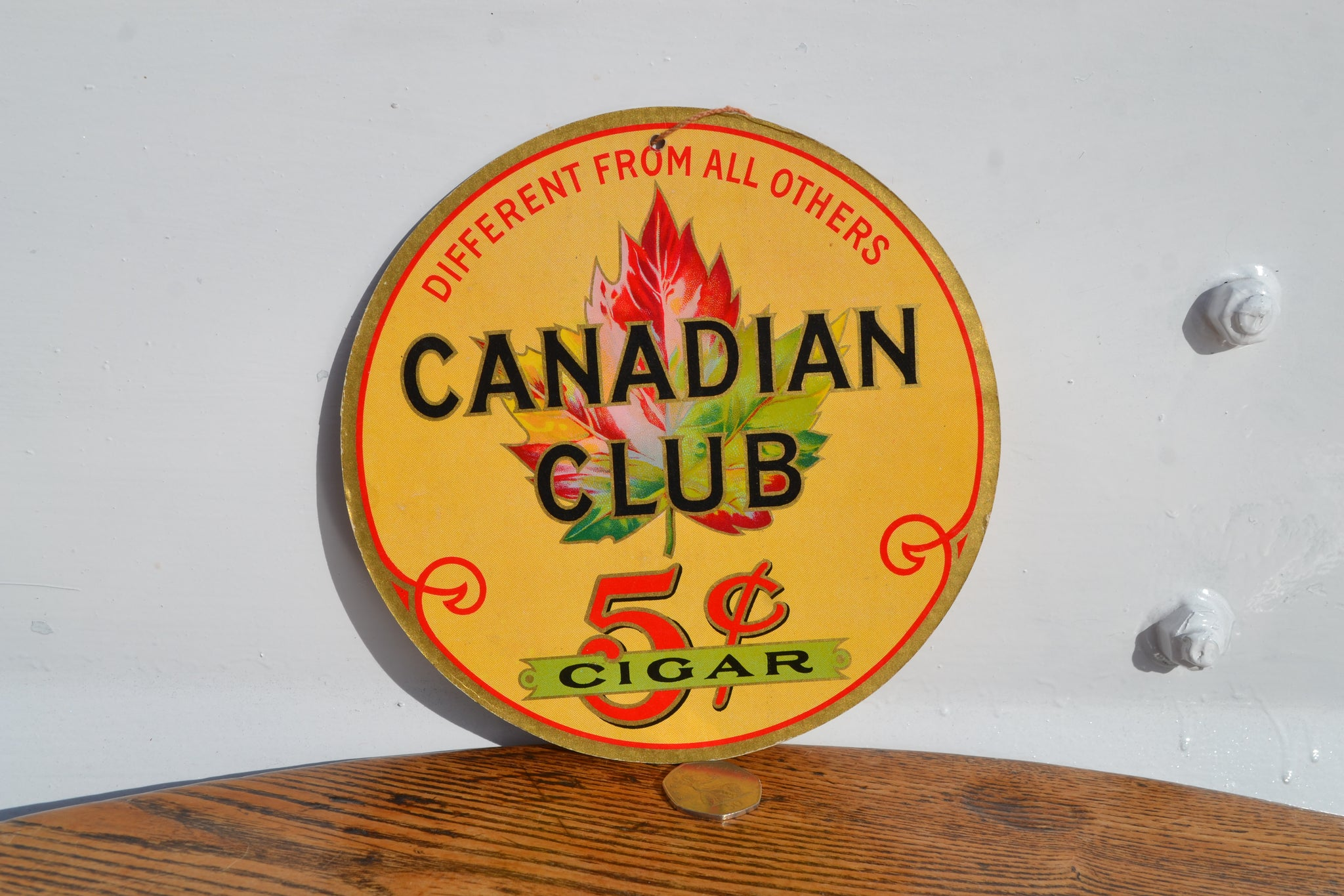 A vintage Canadian Club Cigar showcard