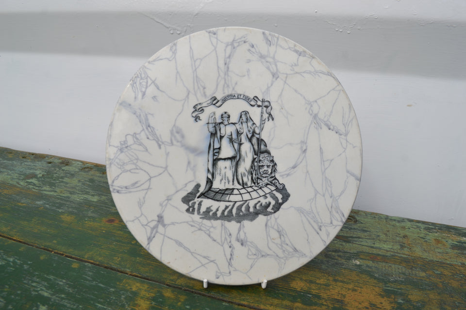 An antique marbled circular scale plate