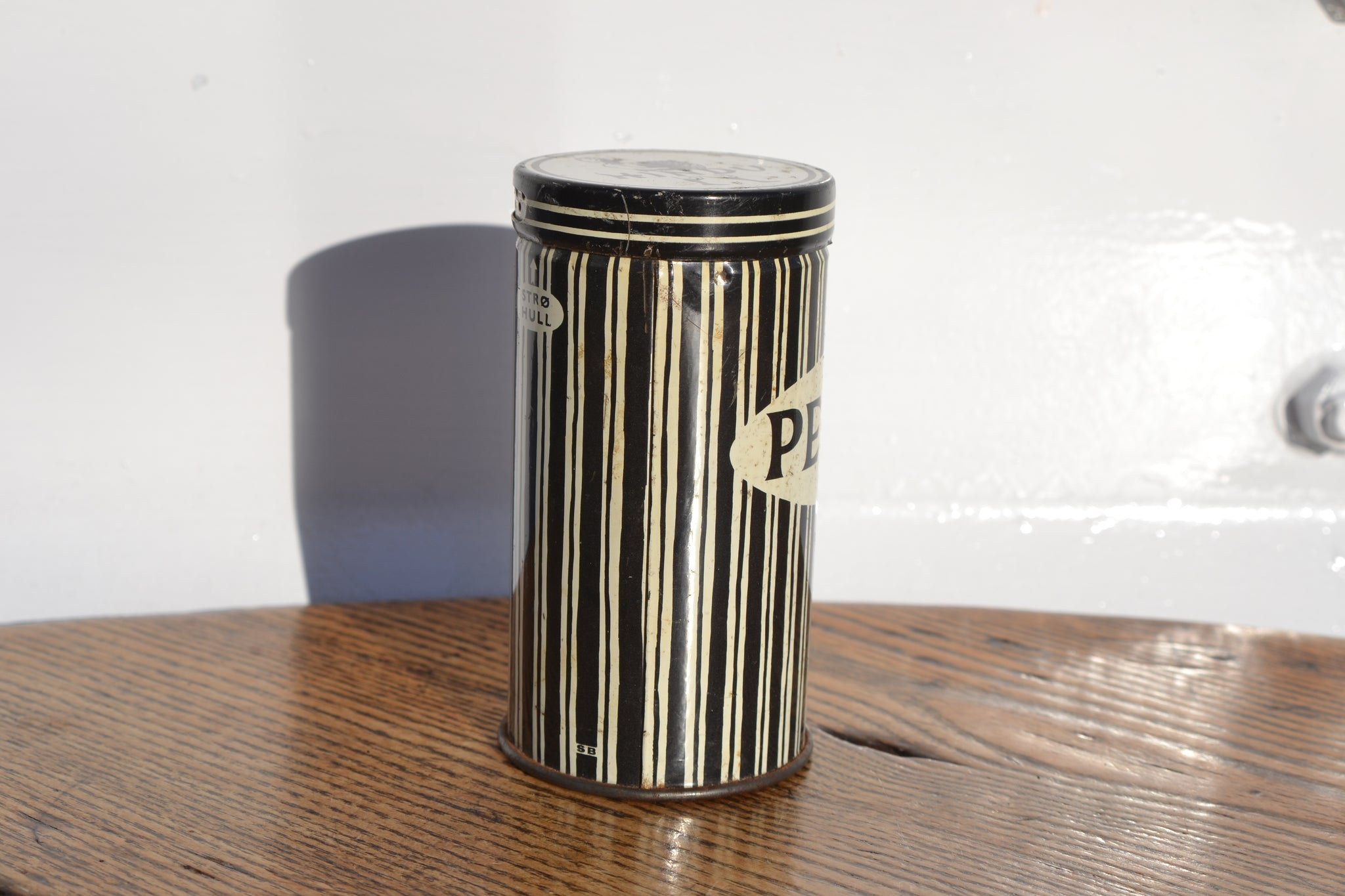 A Norwegian Hindu Pepper tin shaker