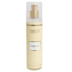 A 135 ml bottle of DeBelle Fine Fragrance Body Mist Madeline - Floral Body Mist