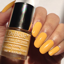 Load image into Gallery viewer, DeBelle nail polish swatch - muted yellow nail polish for summers 2021