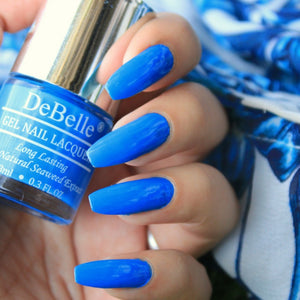 Bright blue nail polish shade like azure stone