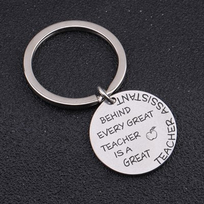 Engraved Behind Every Great Teacher Is A Great Teacher Assistant  Key Ring