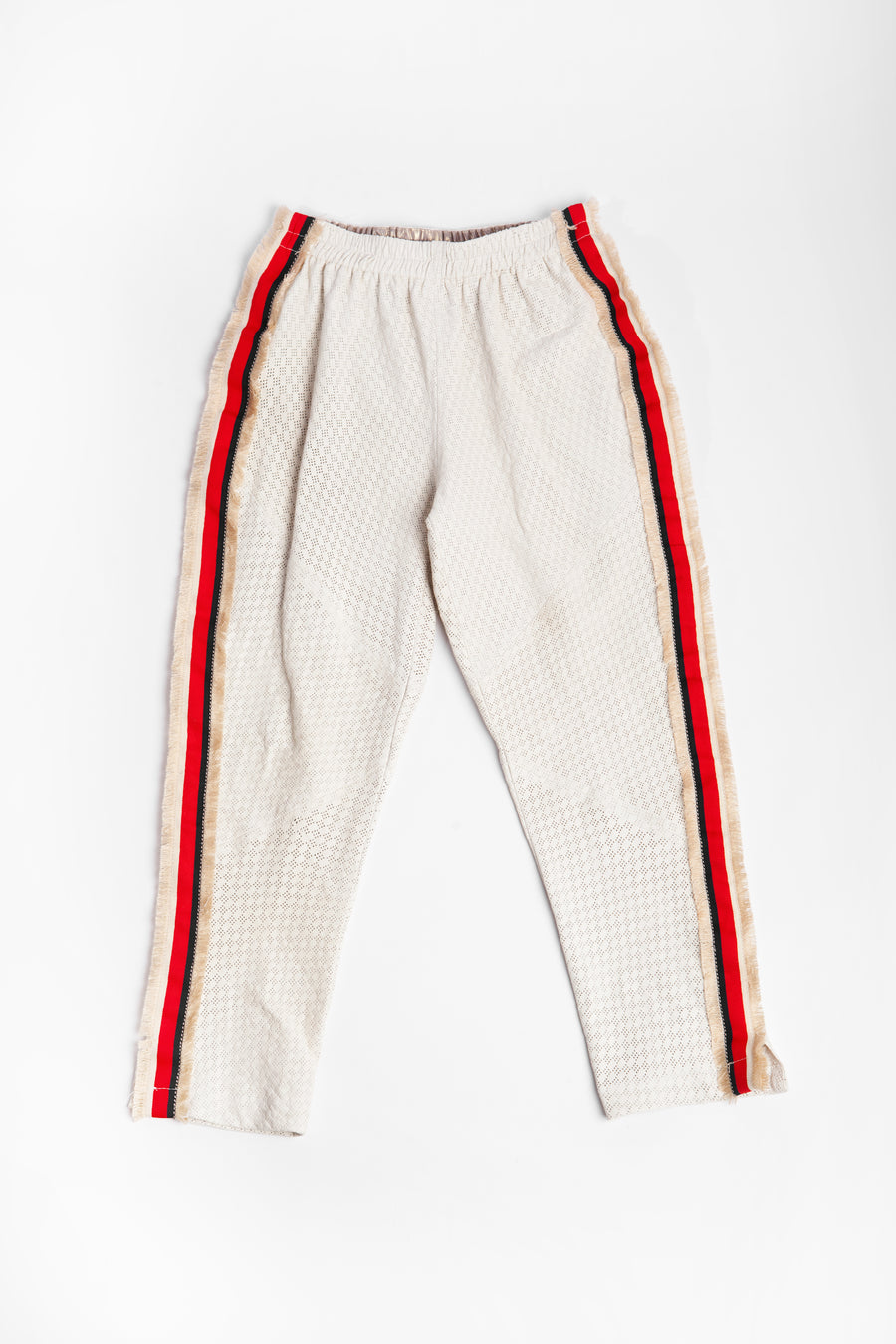White leather pants with red and blue stripe