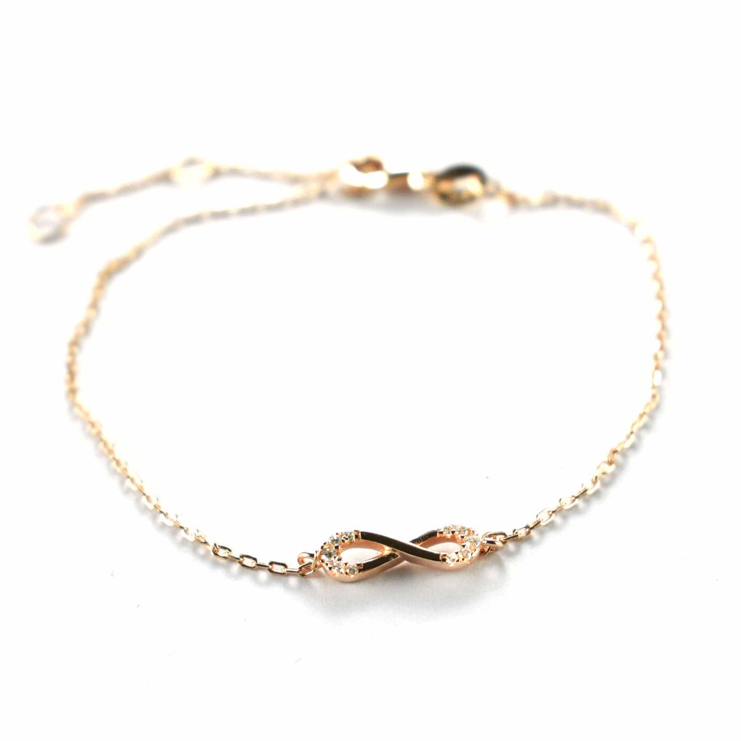 Bow pattern silver bracelet with white CZ & pink gold plating
