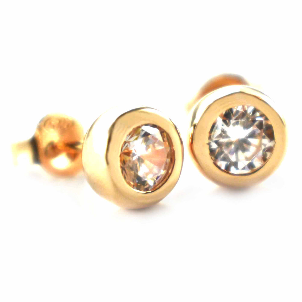 Channel set earring with white CZ & pink gold plating