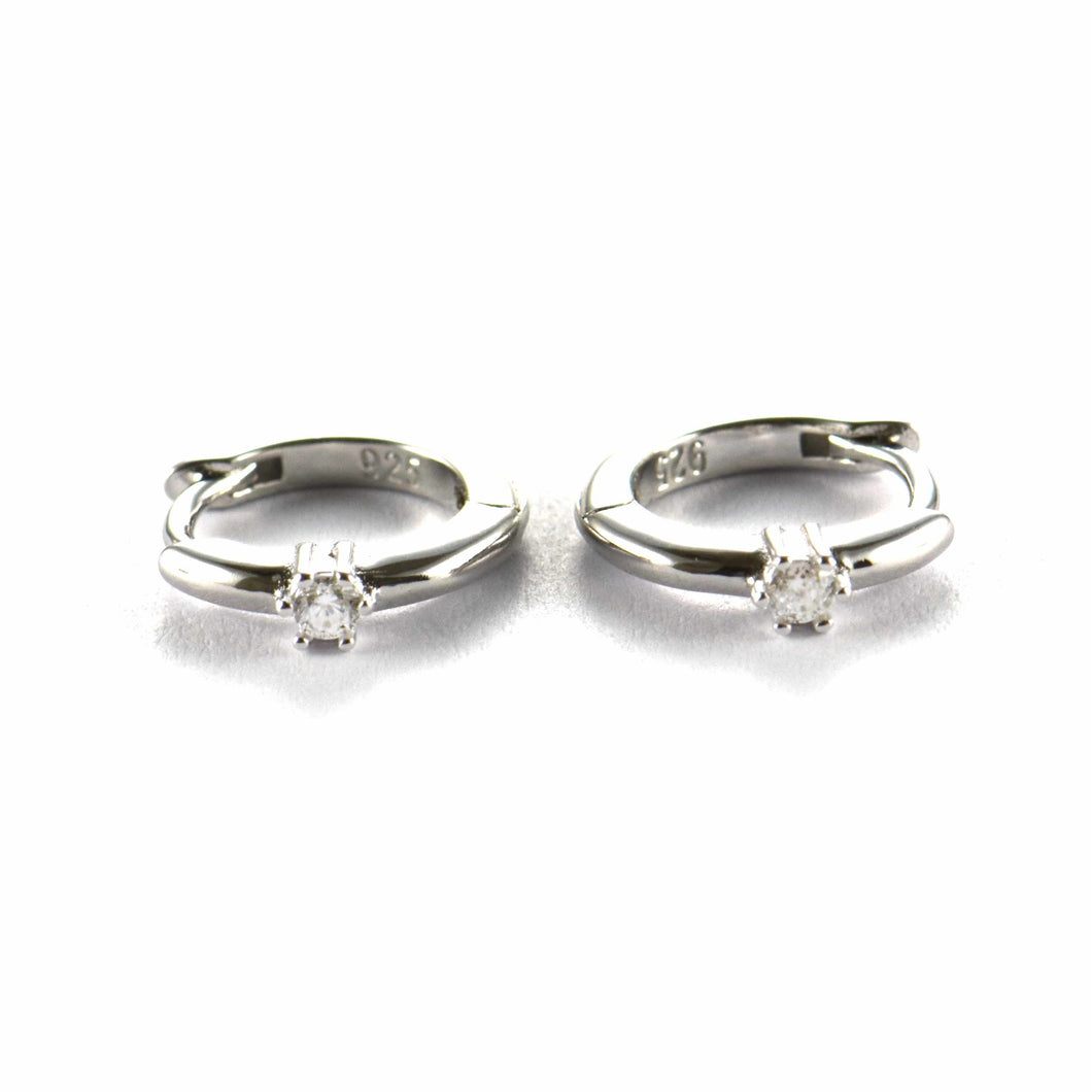 Circle silver earring with one CZ