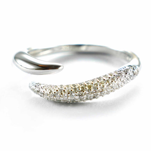 Open silver ring with small white CZ