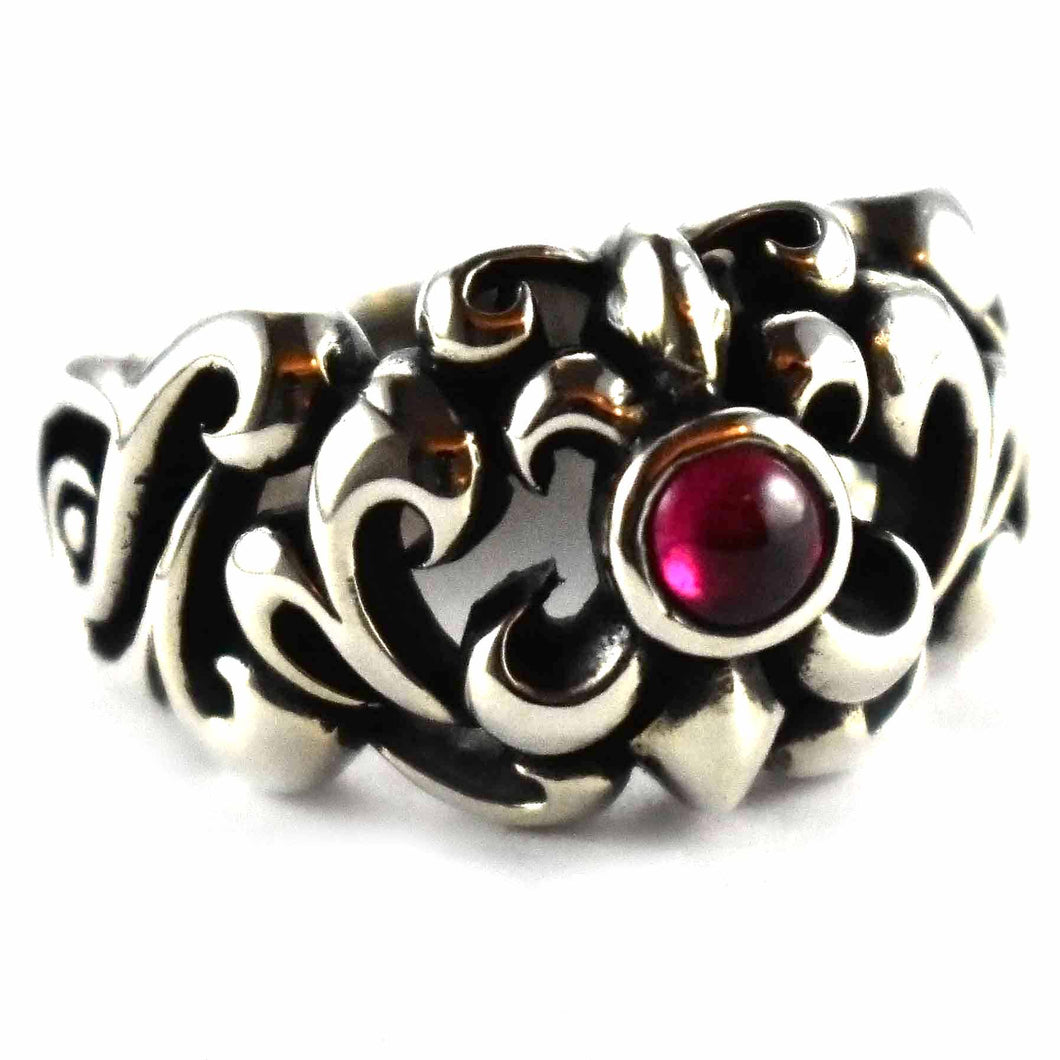 Scout pattern with garnet stone silver ring