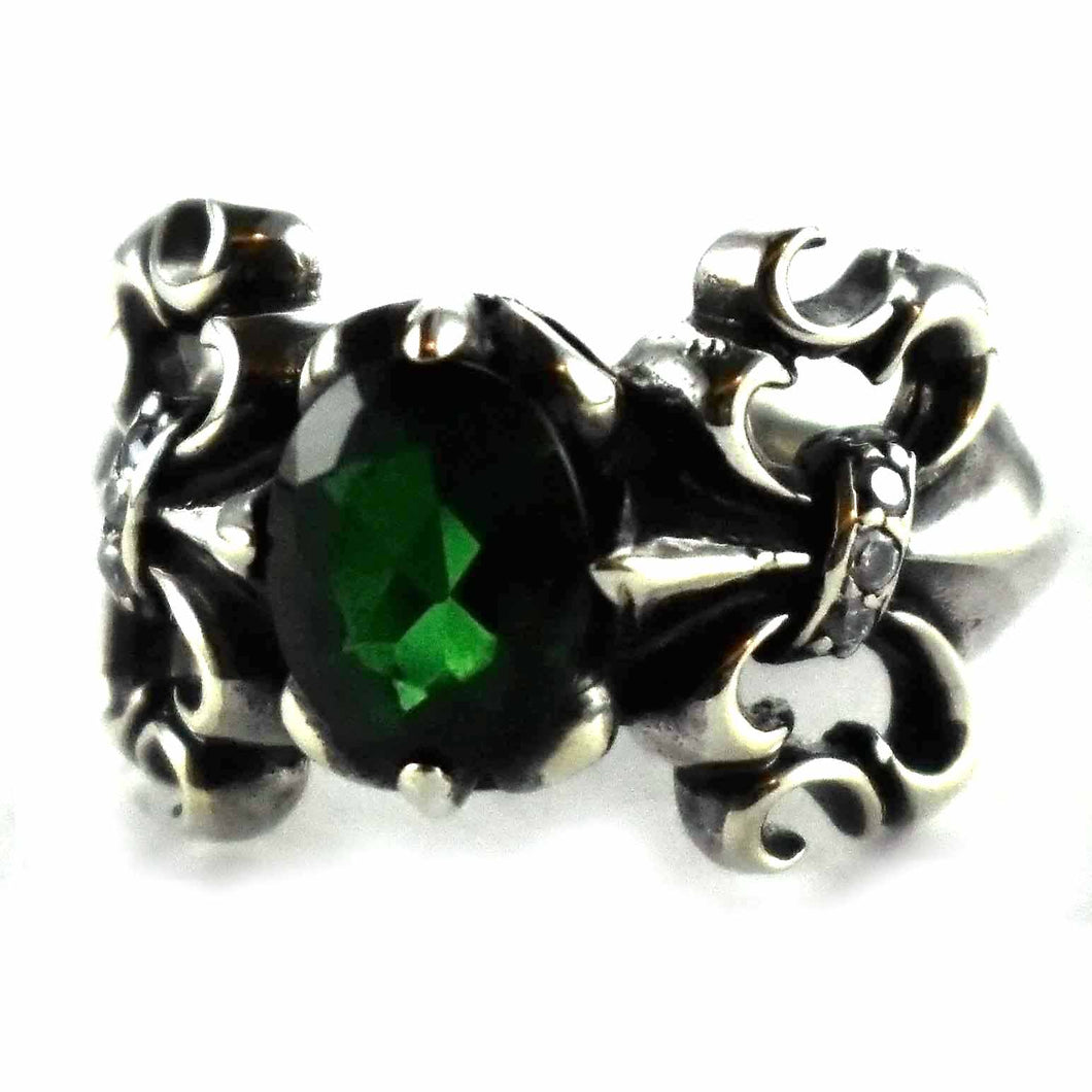 Scout pattern with oval green cubic zirconia silver ring