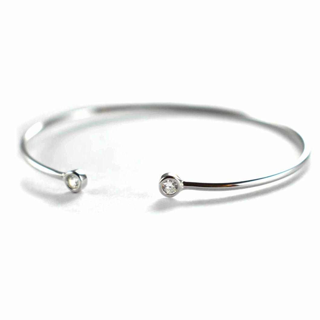 Silver bangle with channel set CZ & platinum plating