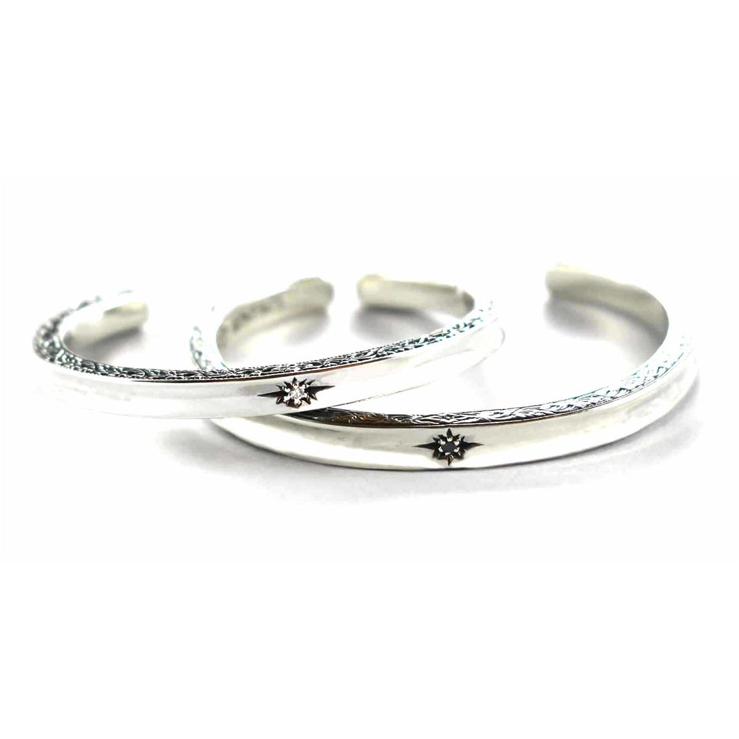Silver couple bangle with white & black cubic zirconia