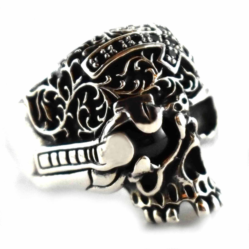 Skull with black oval silver ring