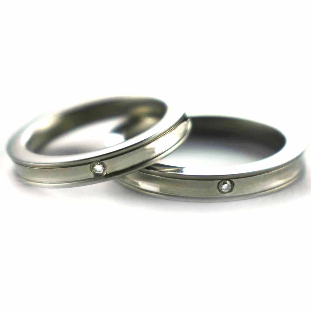 Stainless steel couple ring with round pattern & CZ