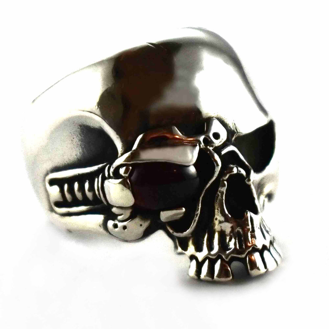 skull ring with black oval stone in eye silver ring
