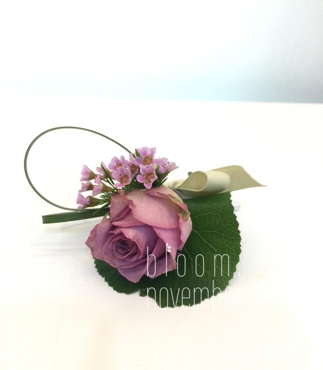 purple corsage flower