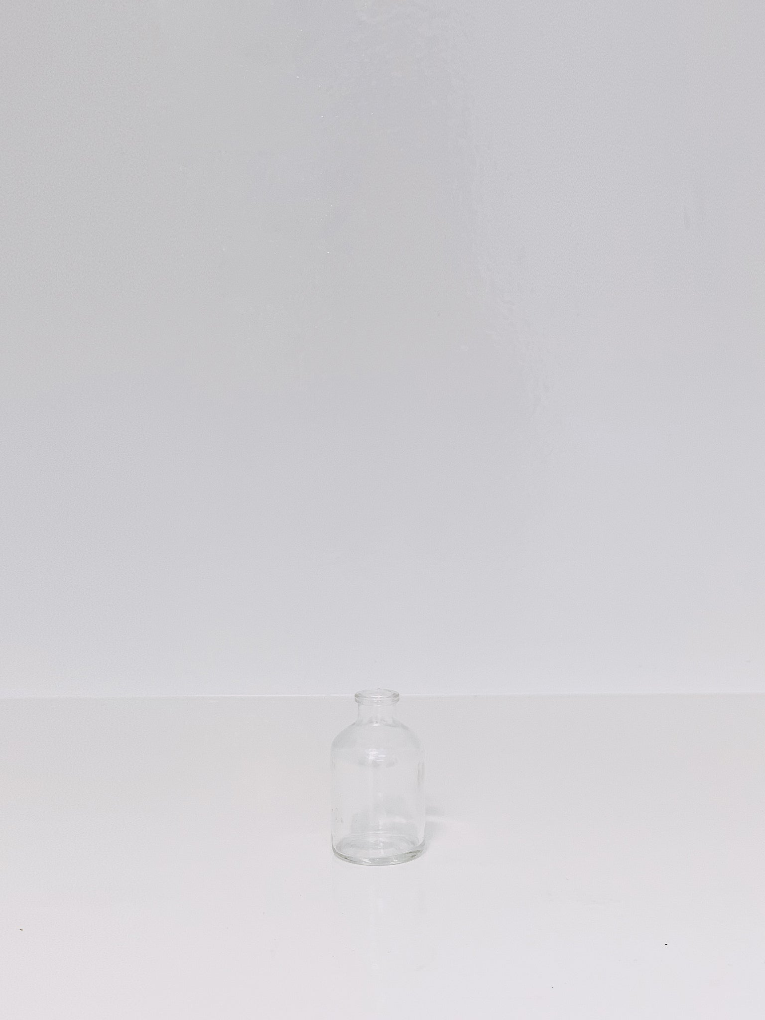 small glass bottle