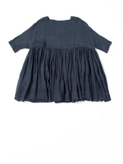 wide indigo dress with ruffles