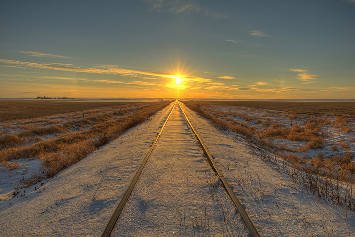 setting sun at the end of the tracks in saskatchewan