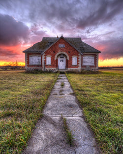 Netherhill abandoned school by kindersley saskatchewan at sunset