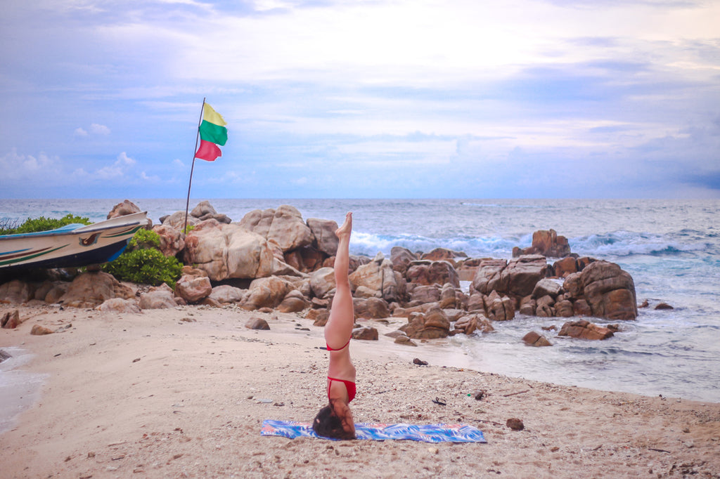 headstand on kosha yoga co. yoga mat
