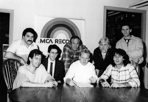 Signing our recording contract with MCA records in Bruce Allen's office. Left-Right: Tuerino Barbero, MCA; Randy Burgess, Bass; Randy Gould, Guitar; Bruce Allen; Cliff Jones; John Alexander, Head of A&R MCA Records Canada; Andrew Johns, Keyboards. January 1988.
