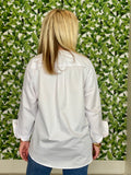 women standing backwords showing the back of a white kristie blouse