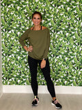 women who is ready to exercise wearing a off the shoulder olive green tori top