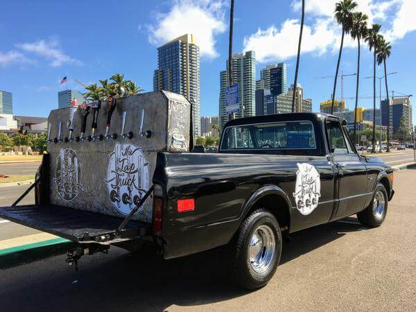 Great times by the wedding bar. '68 Chevy truck serves frosty beers from Huntington Beach to Orange County.