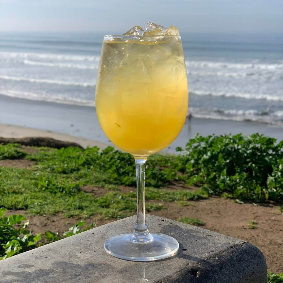 Brunch Mimosa - Draft champagne with a generous splash of passionfruit and pineapple cider - served in a flute or wine glass.