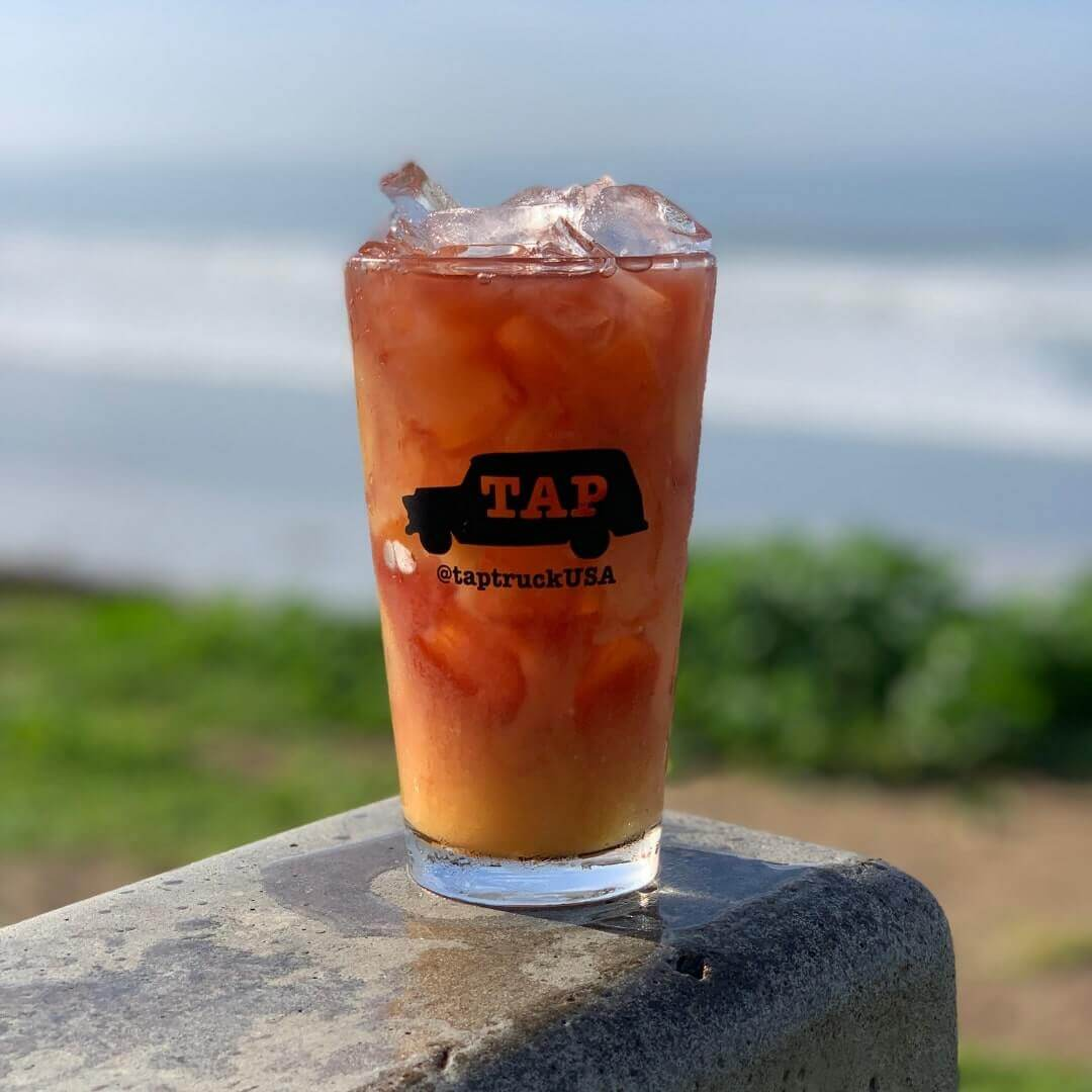 Paradise Rum - Draft Pineapple and Passionfruit Cider mixed with a splash of lime, white rum, and dark rum.