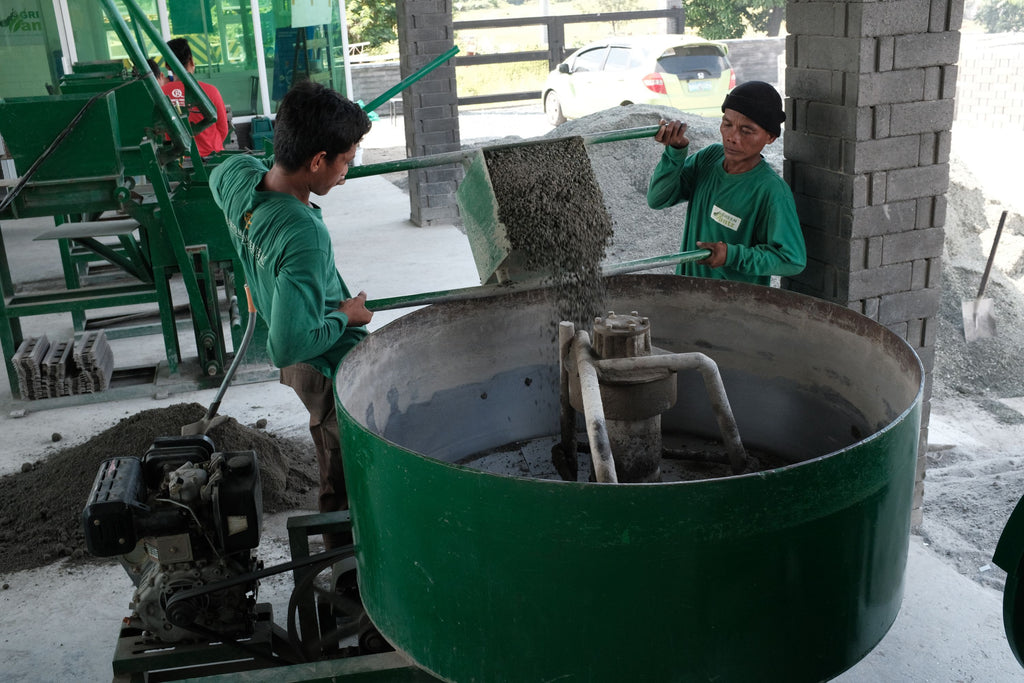 Mixing of gravel sand plastic cement for Green Antz Ecobrick hollow block
