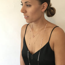 Load image into Gallery viewer, Model wearing gold plated Stunningly Simple Lariat Necklace