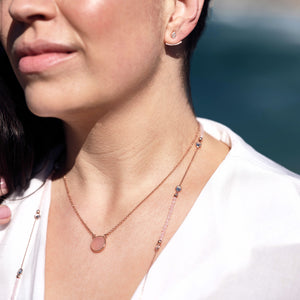model wears necklace with semi-precious pink stone
