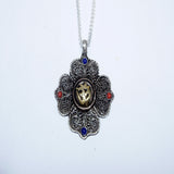 Om inscribed lotus flower pendent