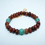 Fair trade Tibetan rosewood buddhist Wrist Mala with Turquoise beads Spacers handmade cheap price jwellery.