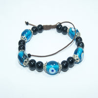 Authentic fashionable trendy buddhist prayer onyx beads jwellery with blue jade wrist mala bracelet handmade in nepal.