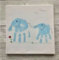 mom and child hand print made into elephant craft