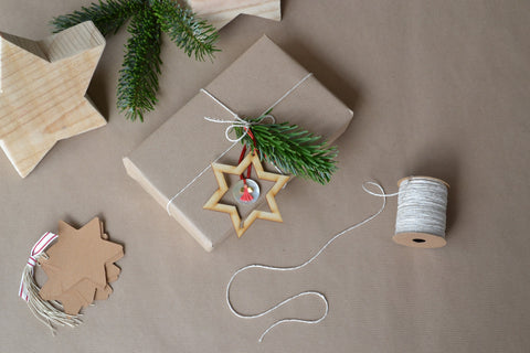gift wrapped in brown paper with leaf sprig