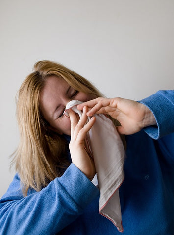 Woman Sneezing with Handkerchief