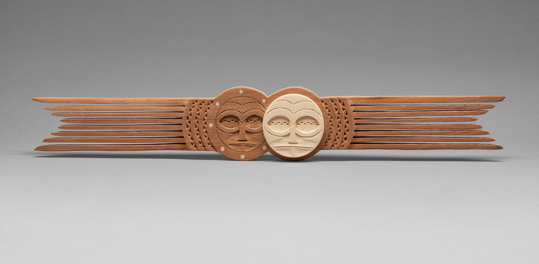 Comb depicting an Eclipse by Greg A. Robinson, Chinook