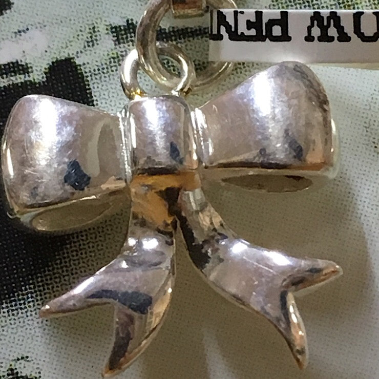 SILVER CLIP ON BOW PENDANT