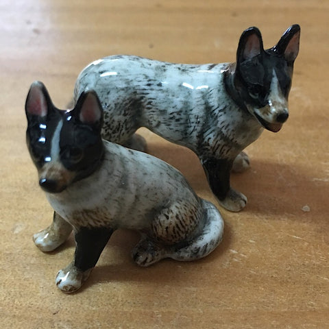 PAIR MINIATURE PORCELAIN CATTLE DOGS SITTING STANDING