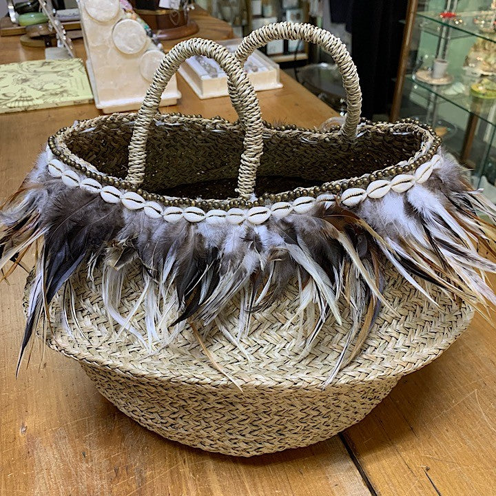 WOVEN BASKET EDGED WITH FEATHERS
