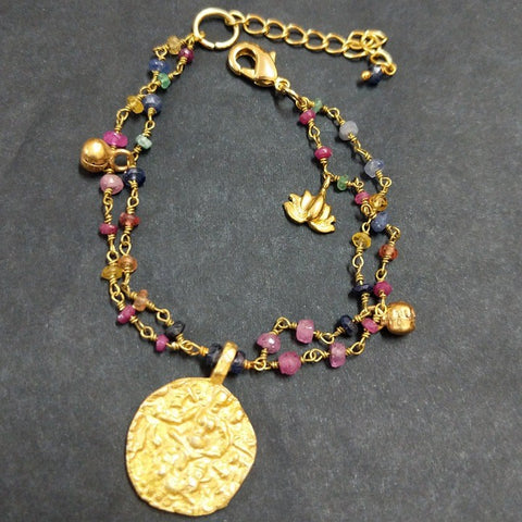 COLOURED TOURMALINE CHARM BRACELET WITH GOLD PENDANT